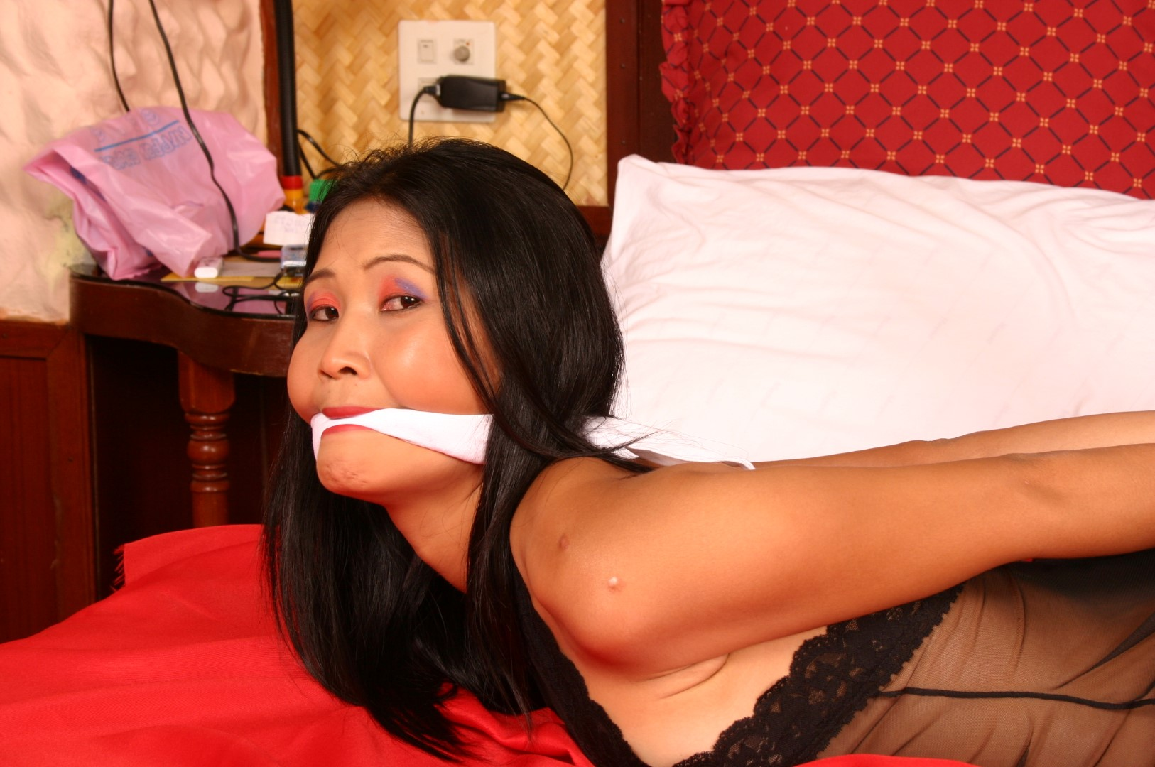 Asian women gagged and hogtied